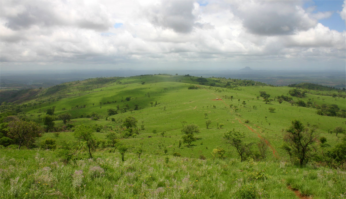 View over the grassland plateau from the slopes above the Falls