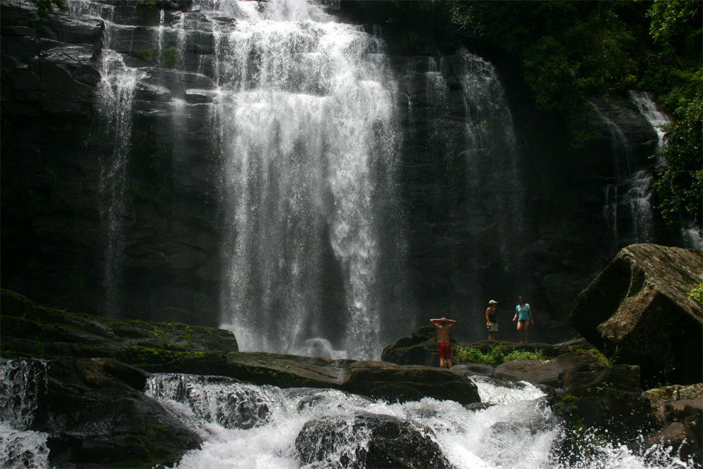 Visitors dwarfed at the foot of the Falls