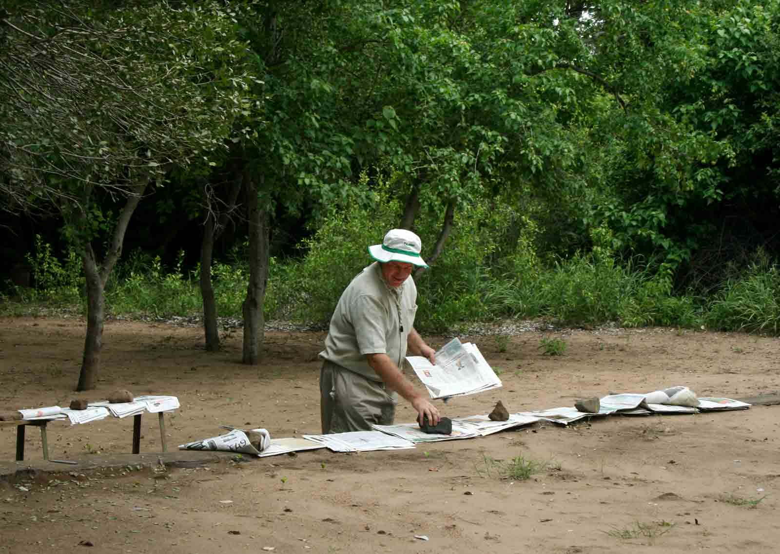 Mark Hyde attempting to dry newspaper one rather cloudy day at the Shashe Wilderness Camp.