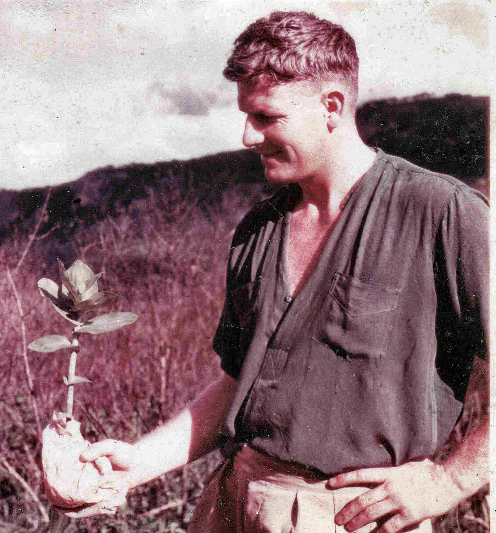 John Ball with an orchid plant
